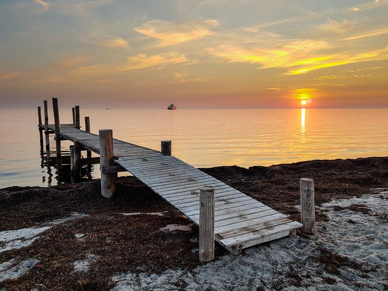 Zapad slnka nad Baltickym morom na ostrove Lolland